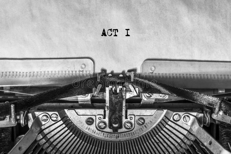 ACT I, typed text on a vintage typewriter, screenplay title heading. On old paper with ink. writer`s idea royalty free stock photo