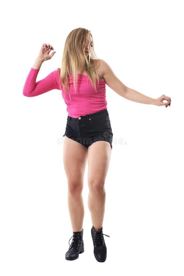Actief lang haarblonde met het slonzige haar onbezorgd dansen en passionately stock fotografie