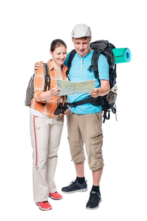Actief paar met rugzakken en kaart op een wit stock afbeelding