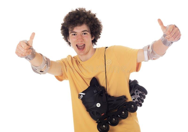 Actieve roljongen met rolschaatsen. royalty-vrije stock afbeeldingen