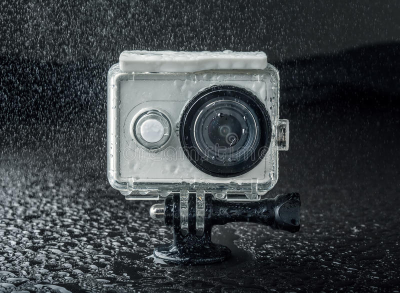 Action camera. On dark background royalty free stock photography