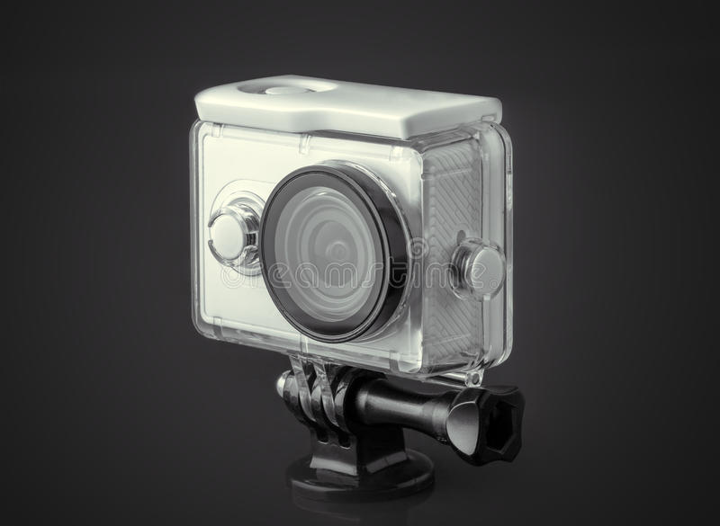Action camera. On dark background stock photography
