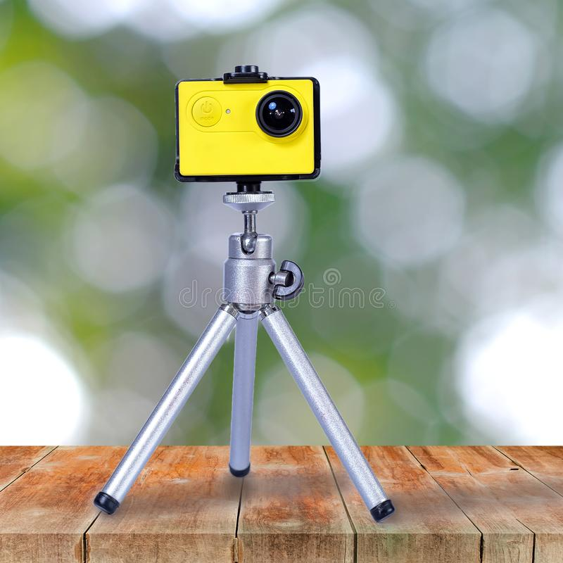 Action camera on mini tripod over wood. Walk stock images