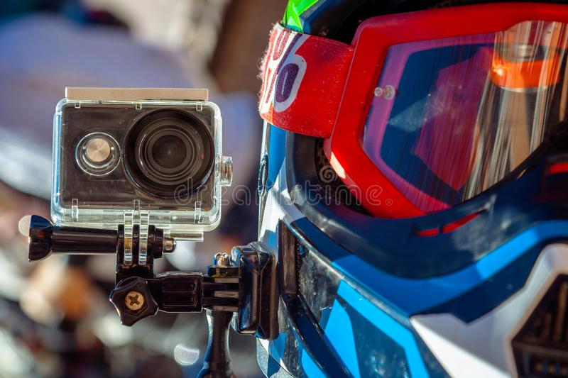 Action camera on a motorcycle rider`s helmet. royalty free stock images