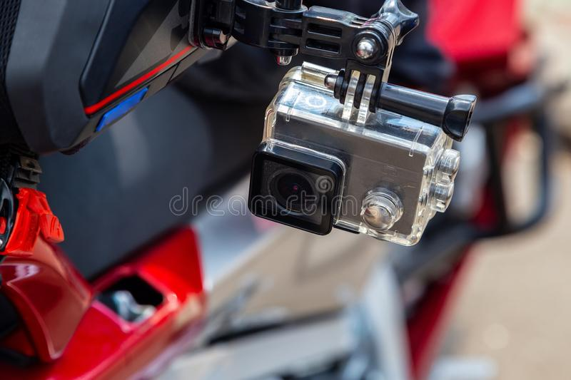 Action camera on a motorcycle rider`s helmet royalty free stock photo