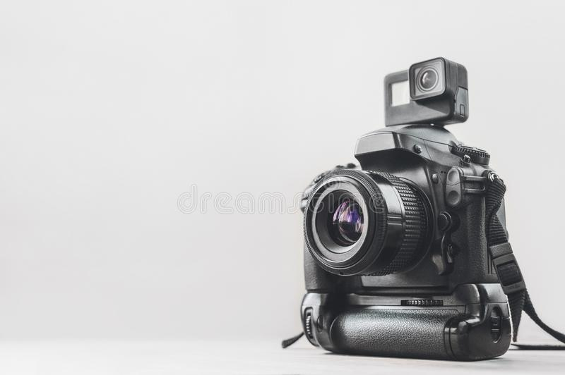 Action camera with a professional camera on a white background. royalty free stock images