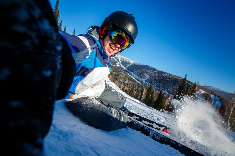 Action camera skier skiing downhill in high mountains during sunny day stock photos
