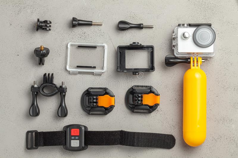 Action camera in a waterproof box and a buoy for diving and various accessories, clamps and holders, remote control. royalty free stock images