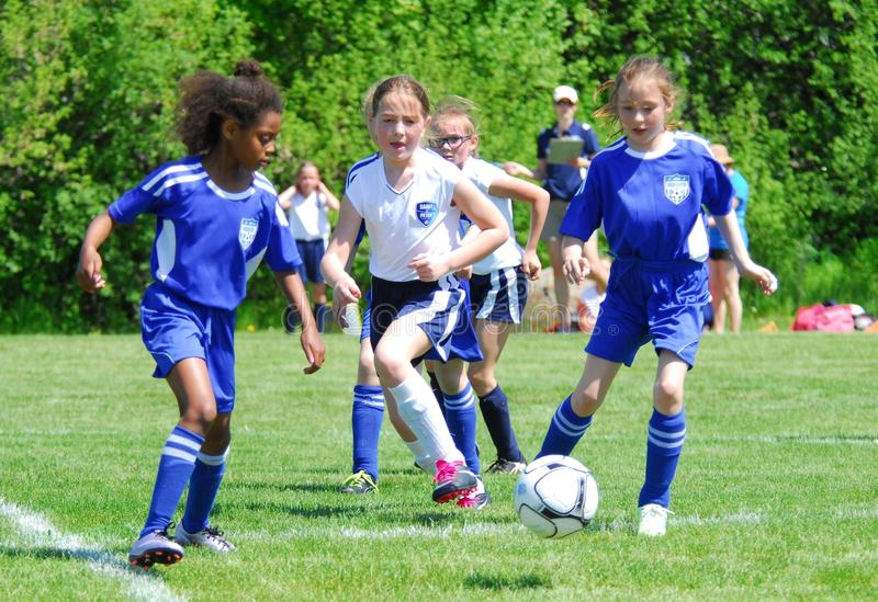 The action is fast in this girls soccer game stock photography