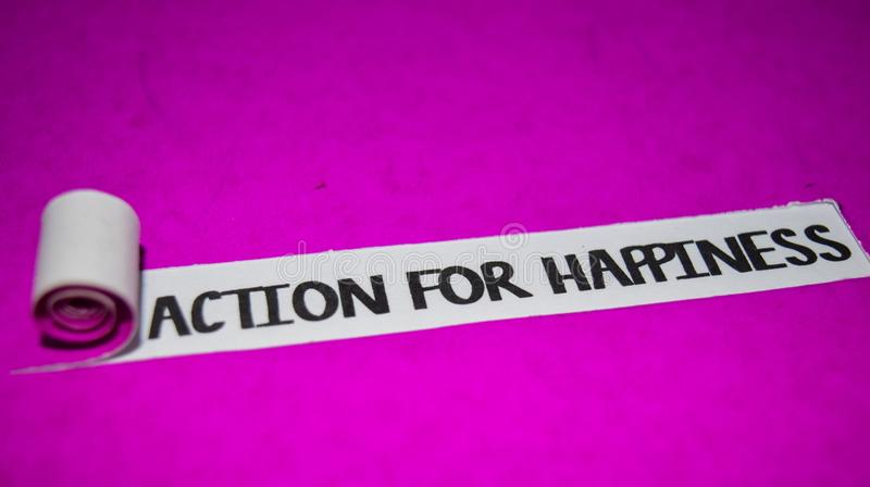 Action For Happiness text, Inspiration and positive vibes concept on purple torn paper stock image
