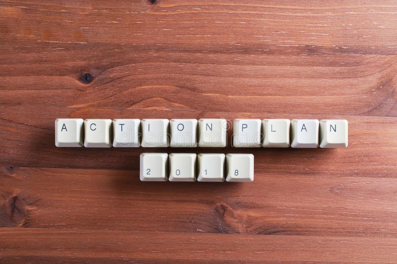 Action plan 2018 on computer keyboard keys buttons on wooden background royalty free stock photos