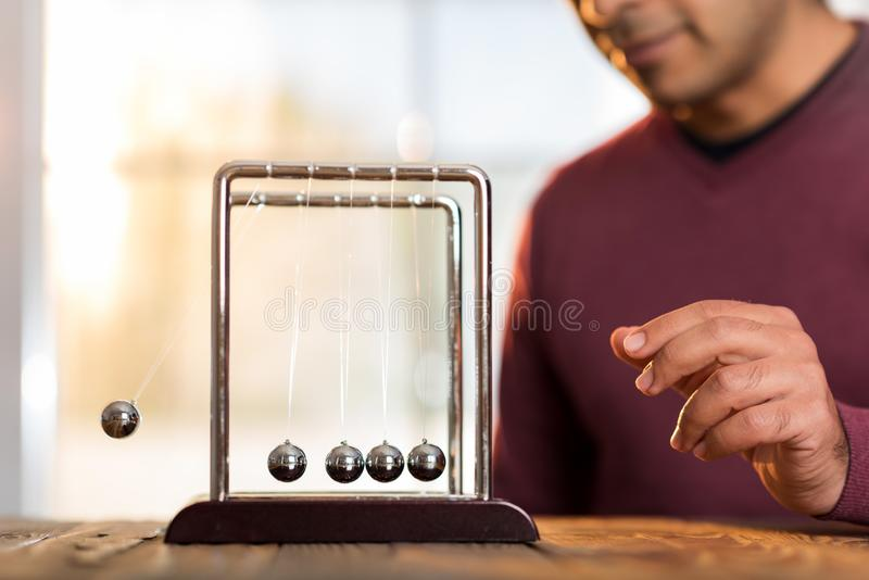 Concept For Action and Reaction in Business With Newton`s Cradle stock photos