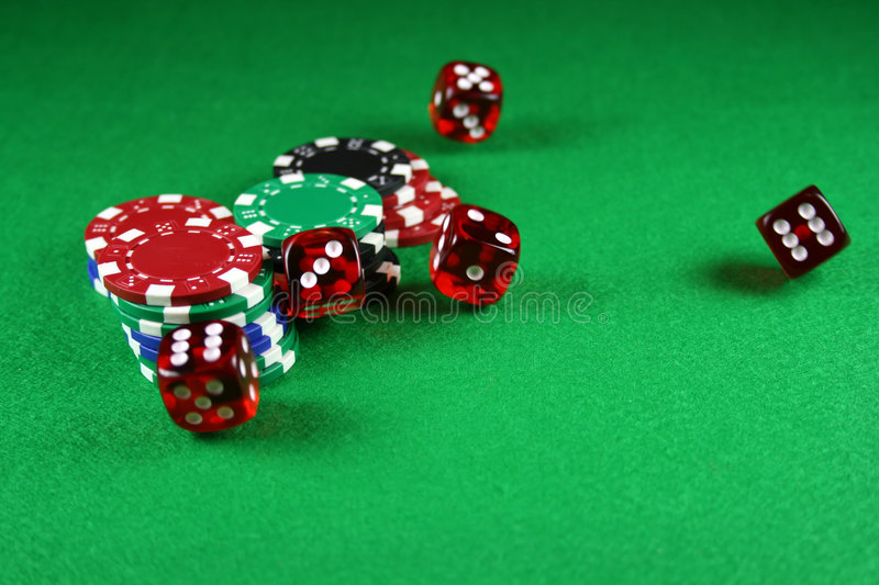 An Action Shot Of 5 Dice Thrown Onto The Table Stock Photos