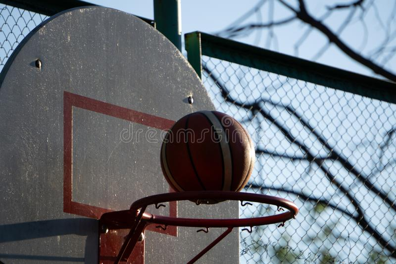 Action shot of basketball going through basketball hoop and net royalty free stock images