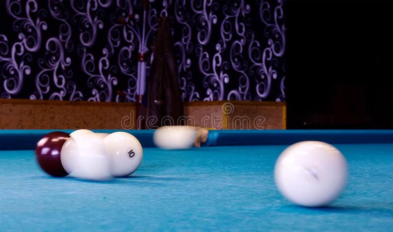 Action Shot Billiards Table Pool Cue and Balls.  stock photography
