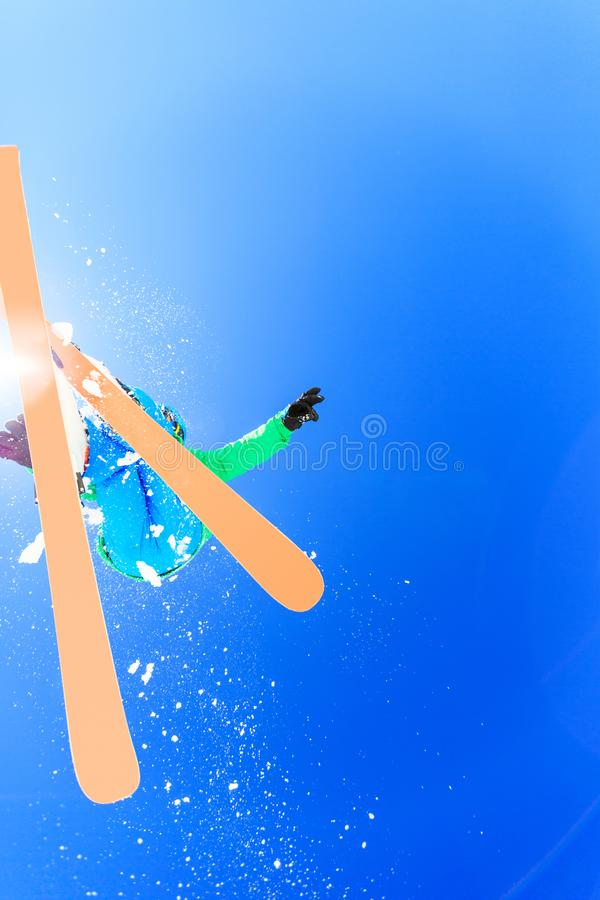 Teenager Jumping With His Skis. Action shot of teenager jumping with his skis royalty free stock image