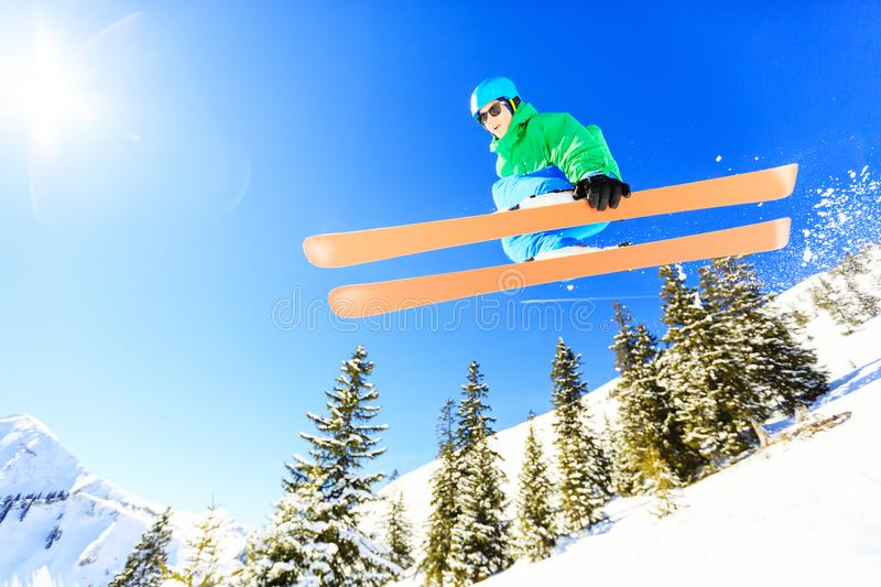 Teenager Jumping With His Skis. Action shot of teenager jumping with his skis stock images
