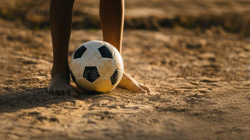 Kids are playing soccer football for exercise. stock photos