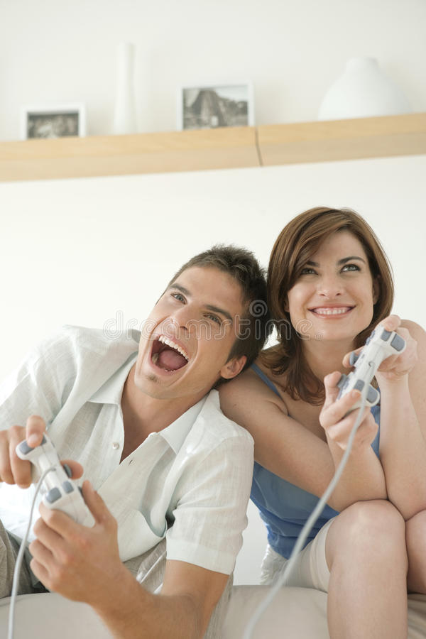 Download Action Video Games on Sofa stock photo. Image of couple - 24787022