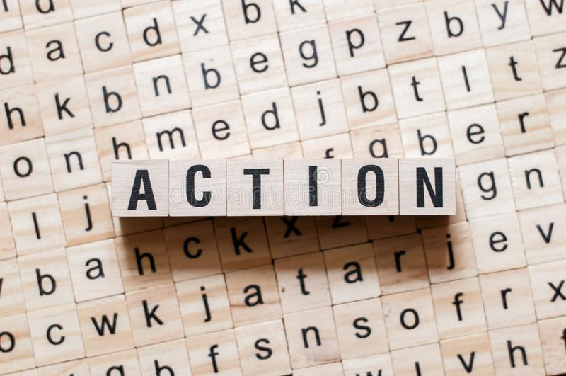 Action word concept. On cubes stock photography