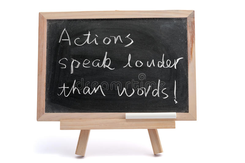 Actions speak louder than words. Saying written on blackboard over white background stock images