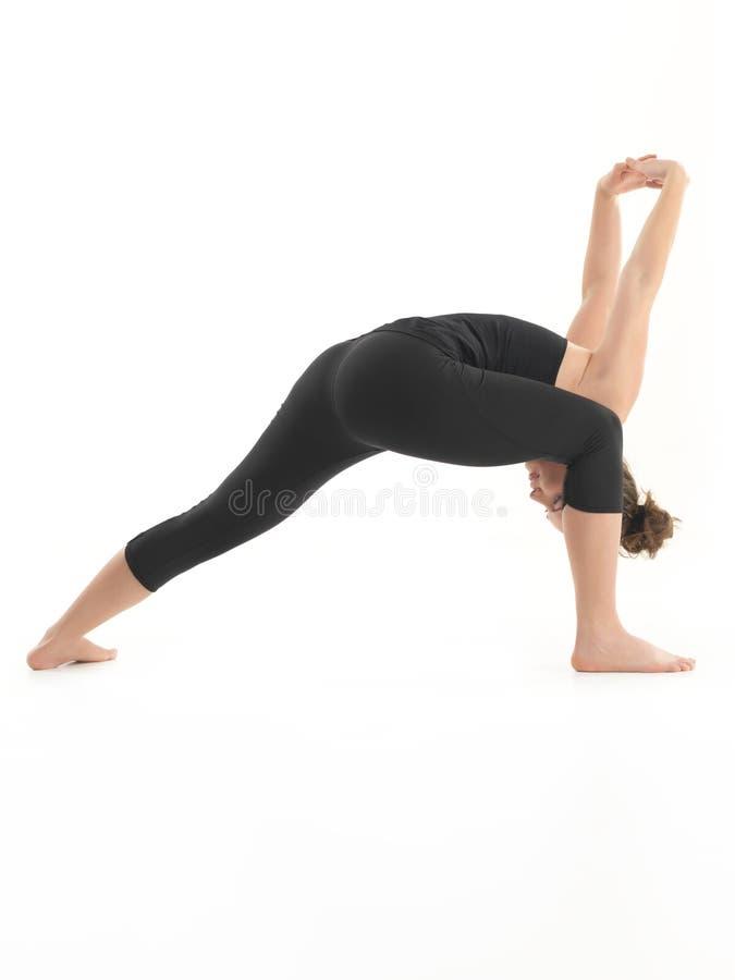 Actitud avanzada de la yoga que estira fotos de archivo libres de regalías