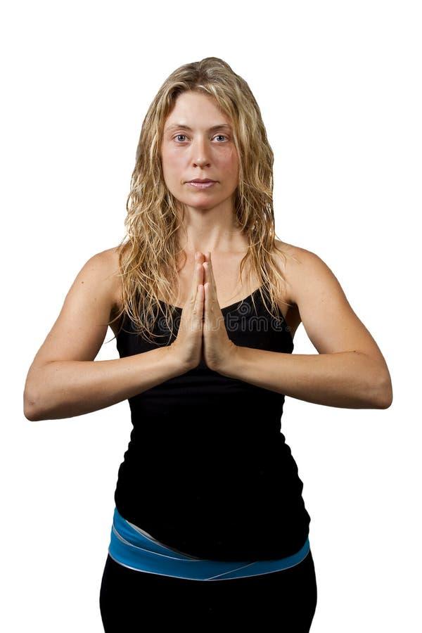 Actitud de la yoga, manos derechas de la mujer rubia unidas imágenes de archivo libres de regalías