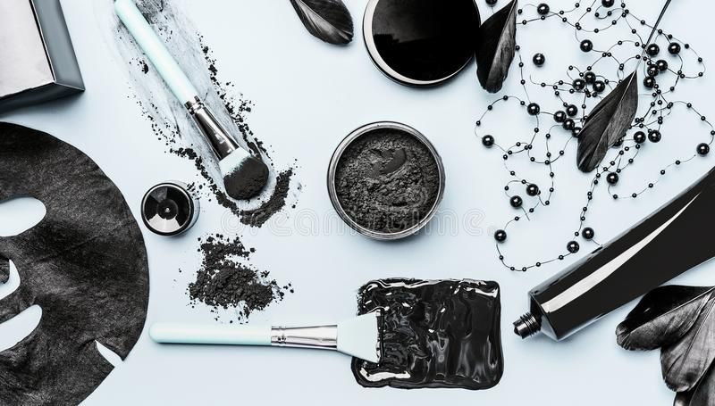 Activated Charcoal facial cosmetic setting with powder, Black head Mask, sheet mask and beauty tools accessories stock photo