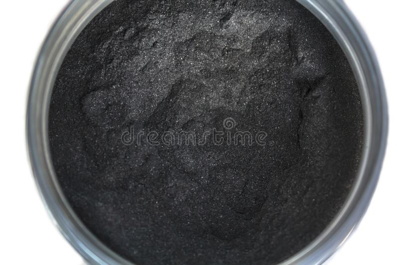 Activated charcoal powder in a jar. Top view of Activated charcoal powder in a jar stock photos