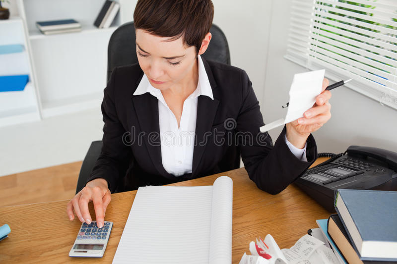 Active accountant checking receipts royalty free stock photo
