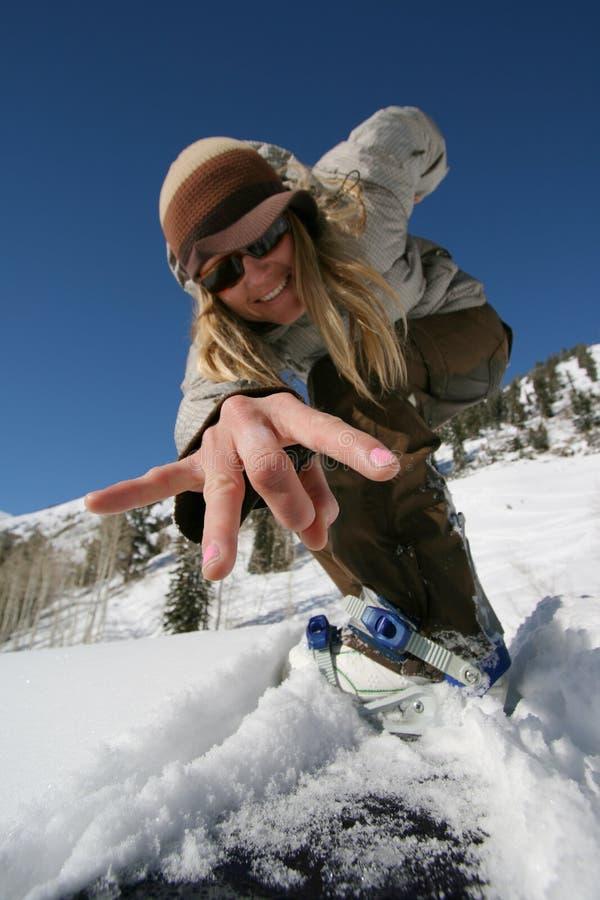 active beautiful camera flicks girl snowboard 库存图片