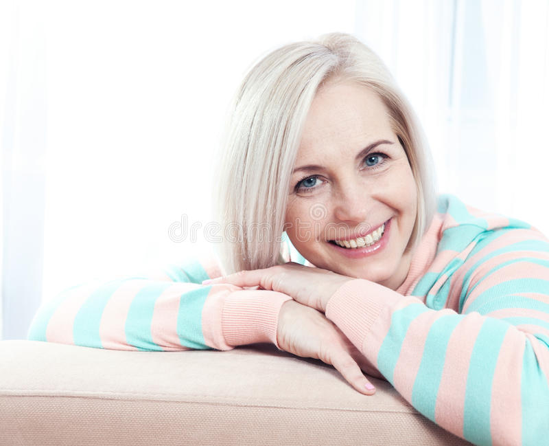 Active beautiful middle-aged woman smiling friendly and looking into the camera. stock image