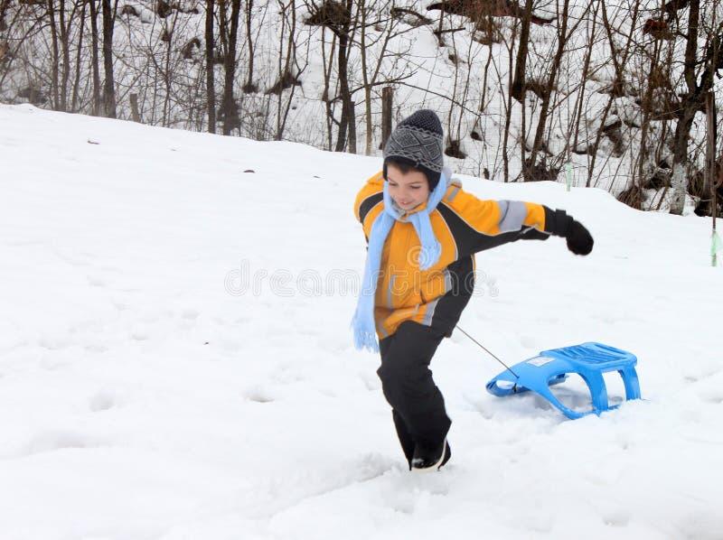 Active boy enjoying a sleigh ride outdoor stock images