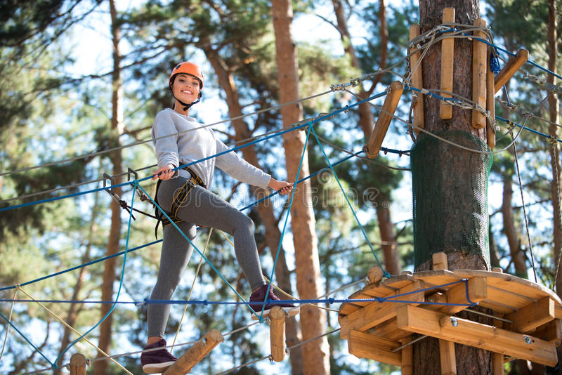 Active cheerful woman approaching the tree stock images