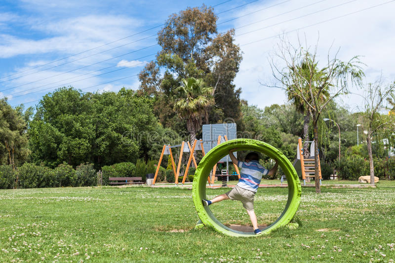 Active child playing in park royalty free stock photography
