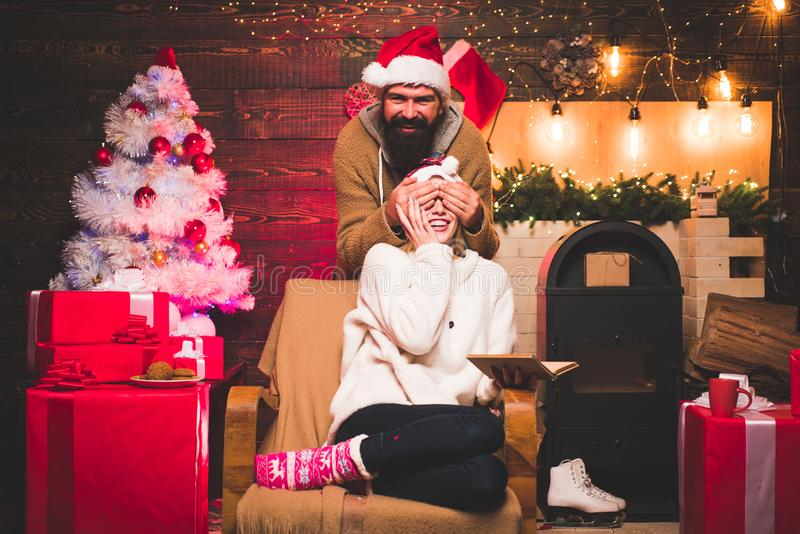 Active couples celebrate Christmas. Greatest Love Stories. Beautiful Couple dressed in a Santa hat. Handsome bearded stock photos