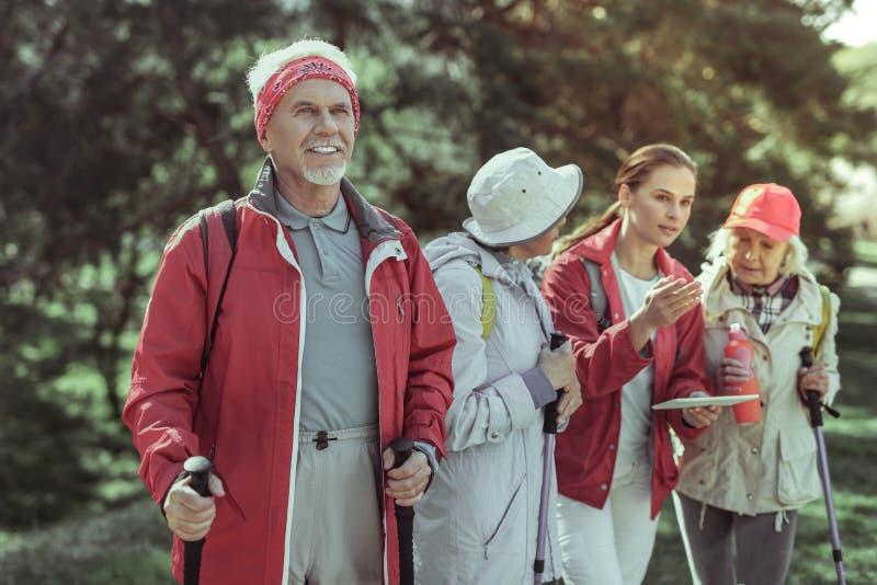 Active elderly man enjoying hiking in mountains stock photo
