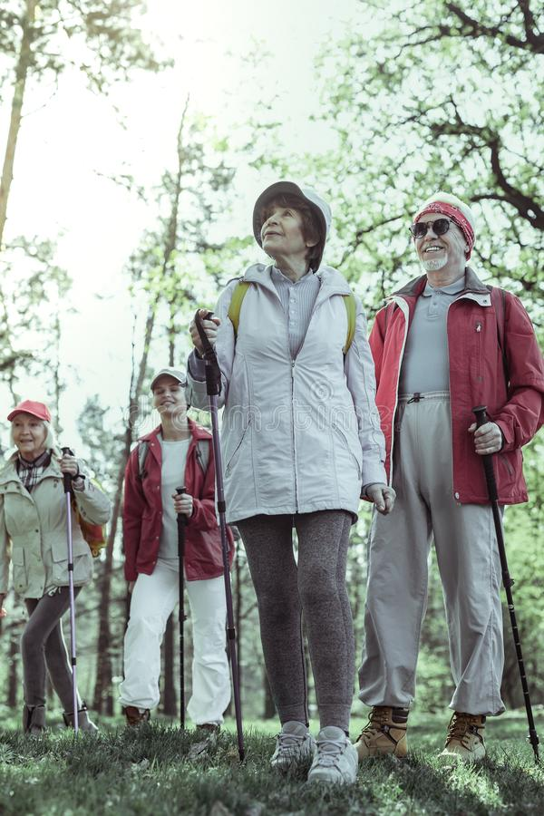 Active elderly people exploring natural attractions on theweekend stock image