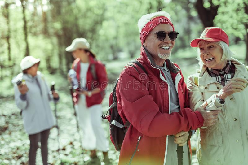 Active elderly people spending time walking in the forest stock image