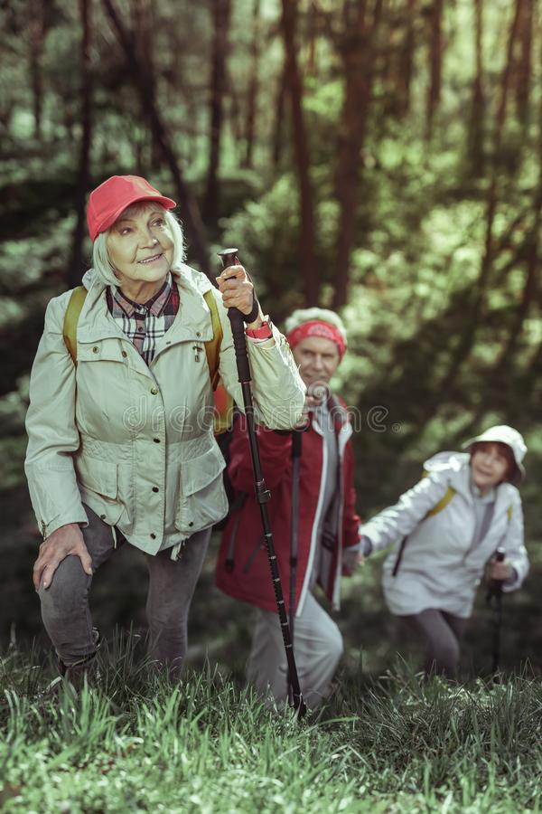 Active elderly woman exploring natural beauty while hiking royalty free stock images