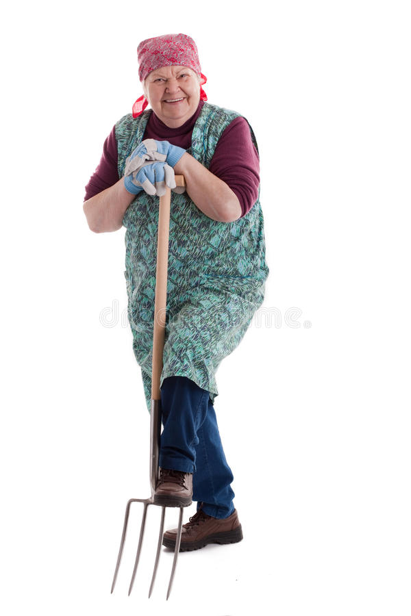 Active elderly woman holding pitchfork 3 royalty free stock image