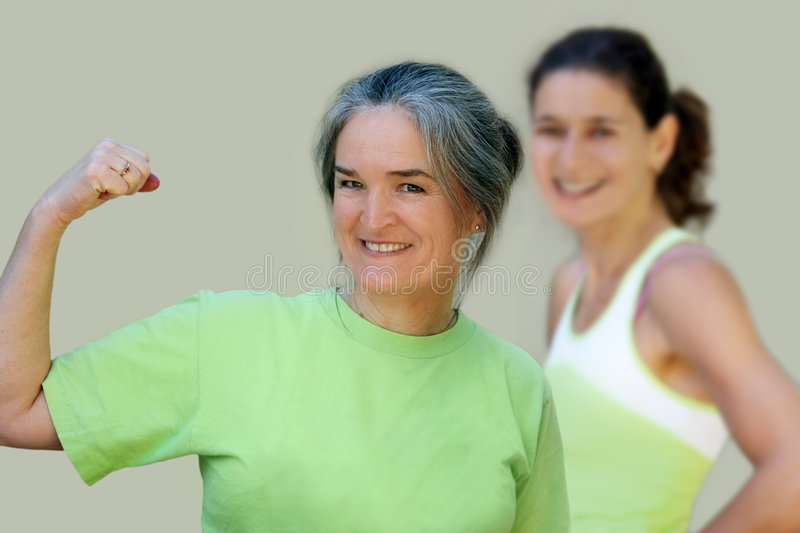 Active family. Athletic mother and daughter royalty free stock photo