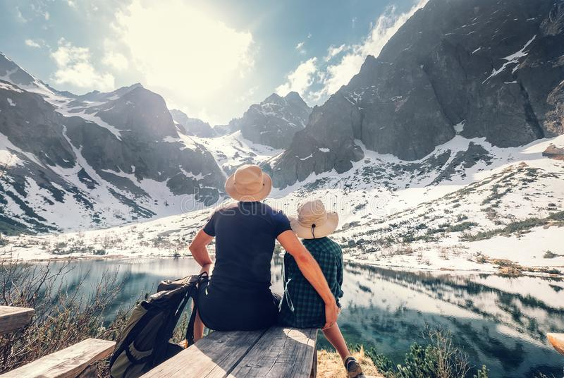 Active family leisure, spring summer hiking. Father and son rest near the mountain lake royalty free stock photos