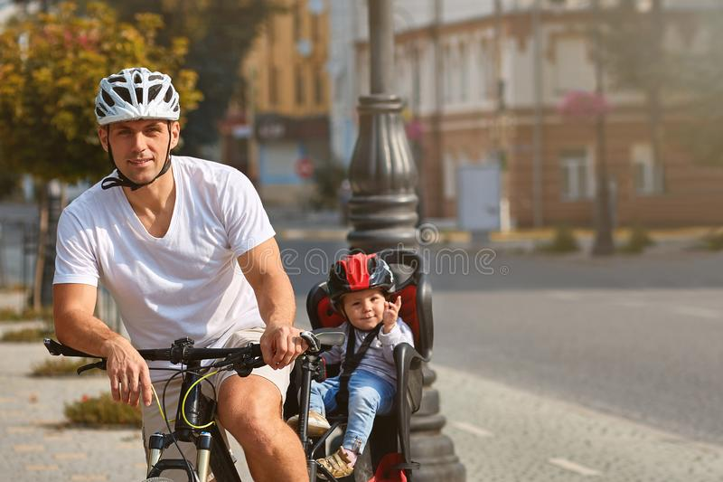 Active family riding bikes in the park summer day stock image