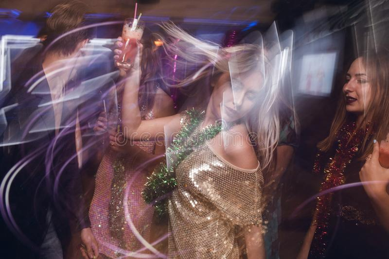 Active female in night club in blurred motion stock photos