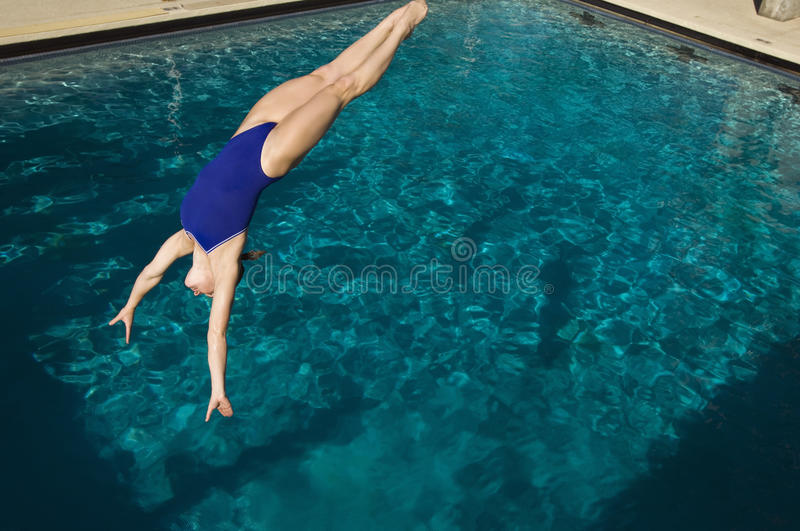 Active Female Swimmer Diving royalty free stock images
