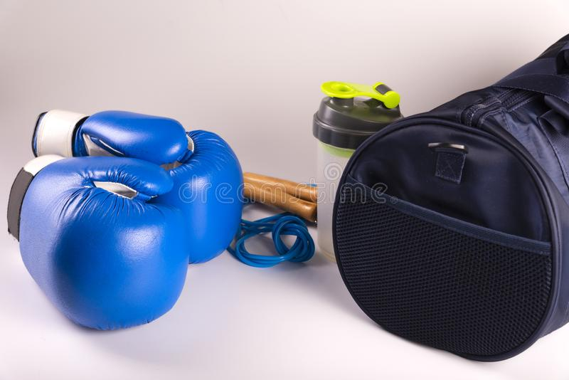 Active fitness kit for boxing, boxing gloves, galloping, bandages for hands, cap on a white background, top view.  royalty free stock images