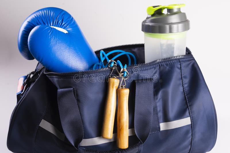 Active fitness kit for boxing, boxing gloves, galloping, bandages for hands, cap on a white background, top view.  stock photos