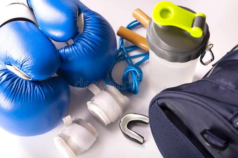 Active fitness kit for boxing, boxing gloves, galloping, bandages for hands, cap on a white background, top view.  stock photography