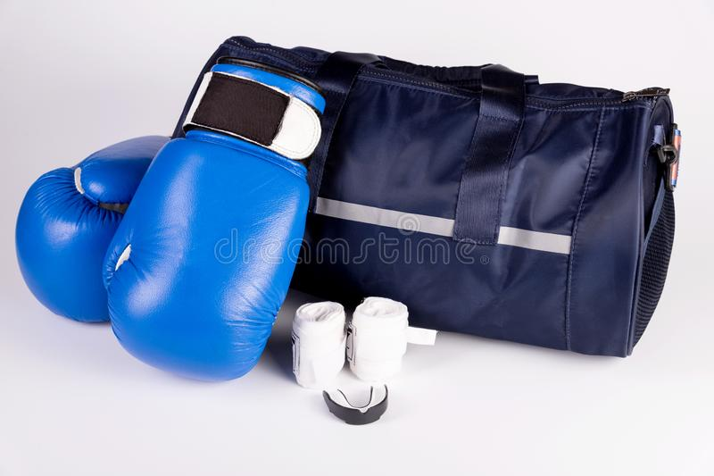 Active fitness kit for boxing, boxing gloves, galloping, bandages for hands, cap on a white background, top view.  royalty free stock image